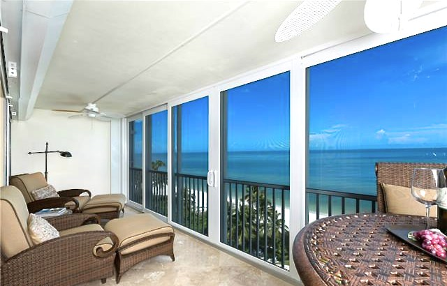 Relax and enjoy the gulf and pool views from your open lanai wit