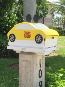 Yellow Pest Control Car Mailbox